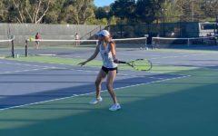 Woodside senior, Daisy Koch, preparing to return the ball