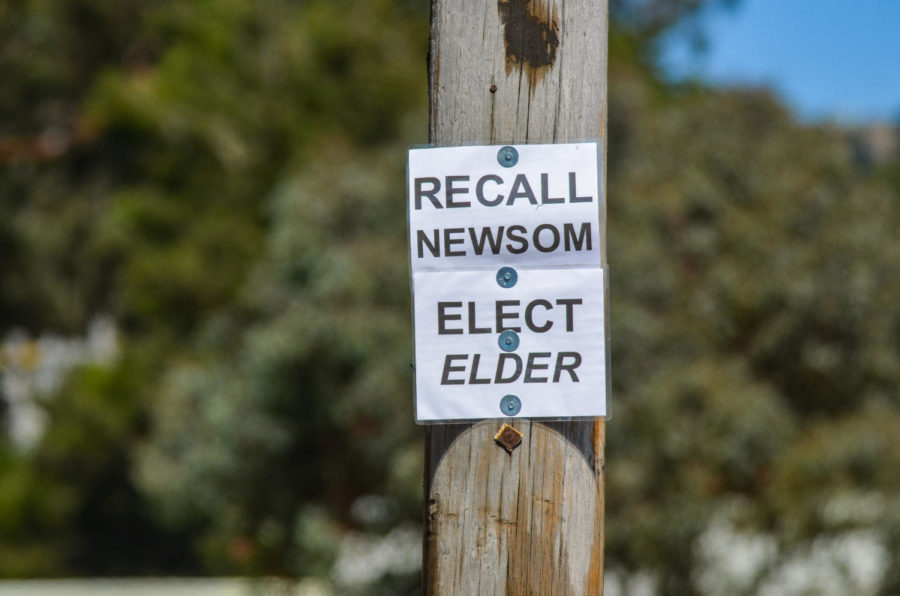 A sign advocating for the recall of Gavin Newsom and the election of front-runner Larry Elder hangs along Highway 1 just outside of Half Moon Bay, California on Monday, September 6, 2021. Voters will be deciding on September 14 whether Newsom will retain his seat in office in an election that has been heavily politicized.