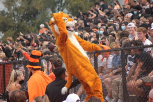 Wilbur the wildcat hyping up the crowd at  Woodsides first rally since coming back from the online school year.