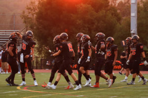 In their first official game of the season, the Woodside Varsity football team lost 47-18.