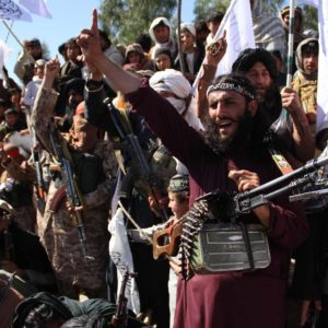 Afghan Taliban fighters and villagers attend a gathering as they celebrate the peace deal signed between the U.S. and the Taliban.